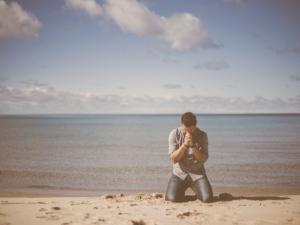 A kneeling bond servant of Christ